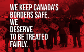 "Picture of demo in NB stating ""We keep Canada's borders safe. We deserve to be treated fairly"""