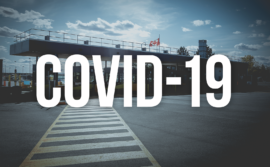 "Image of border crossing with the words ""COVID-19"""