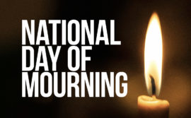 photo of candle with the words 'national day of mourning'