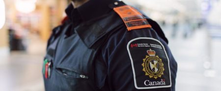 Photo of CBSA officer with orange epaulettes